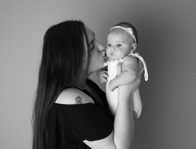 Mummy kissing baby