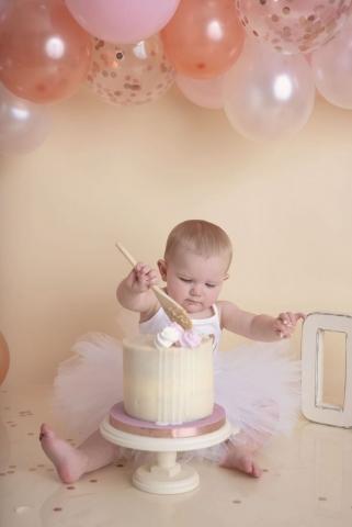 Rose gold balloon arch cake smash